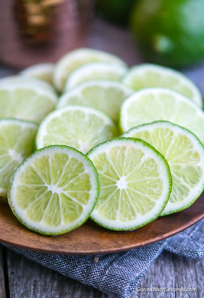 Lime wedges on a wooden plate