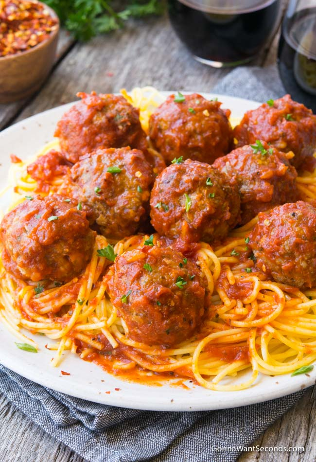 A plateful of spaghetti topped with Baked Meatballs