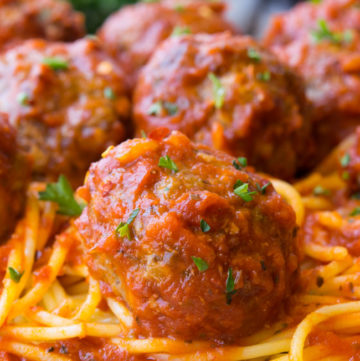Baked Meatballs on top of spaghetti