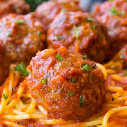Baked Meatballs on top of spaghetti