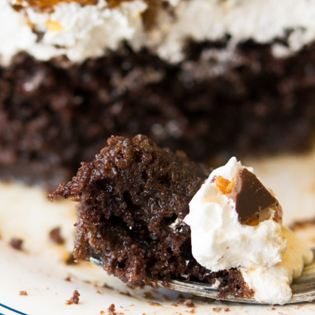 A slice Butterfinger Cake and a piece of cake on fork