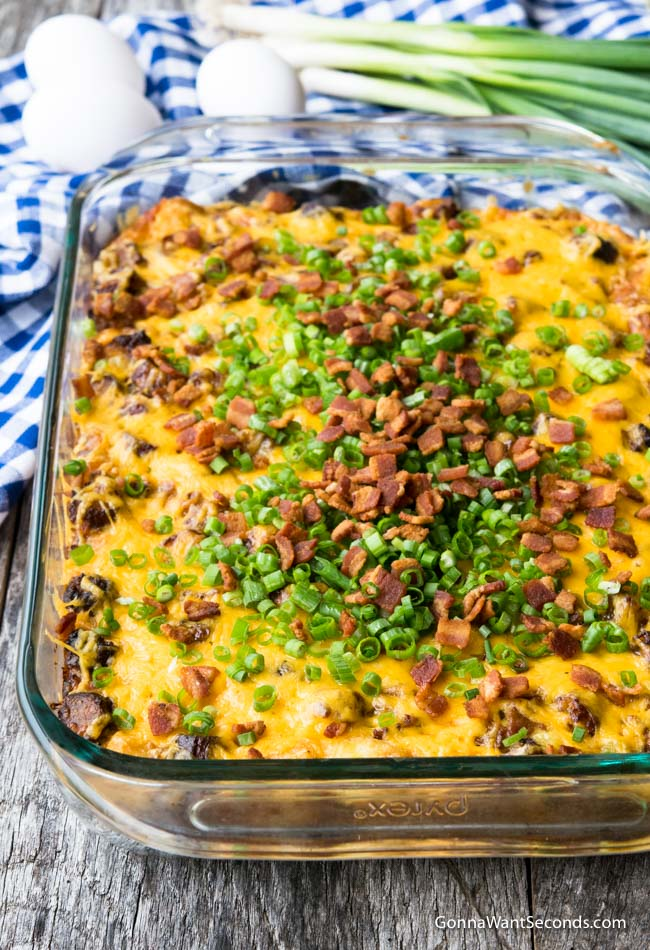 Tater Tot Breakfast Casserole in a 9 x 13 glass baking dish, topped with green onions and bacon