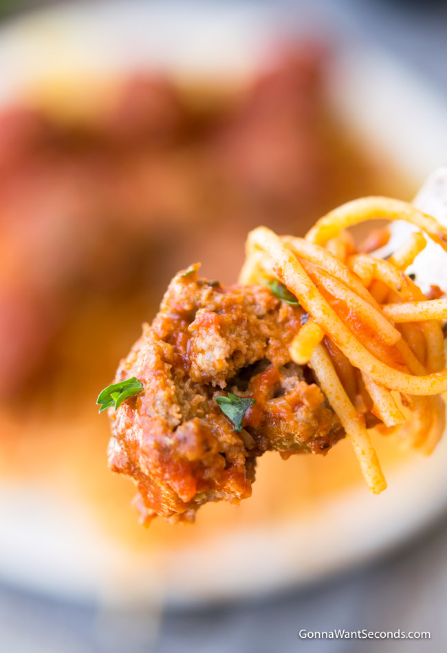 A forkful of Baked Meatball with spaghetti