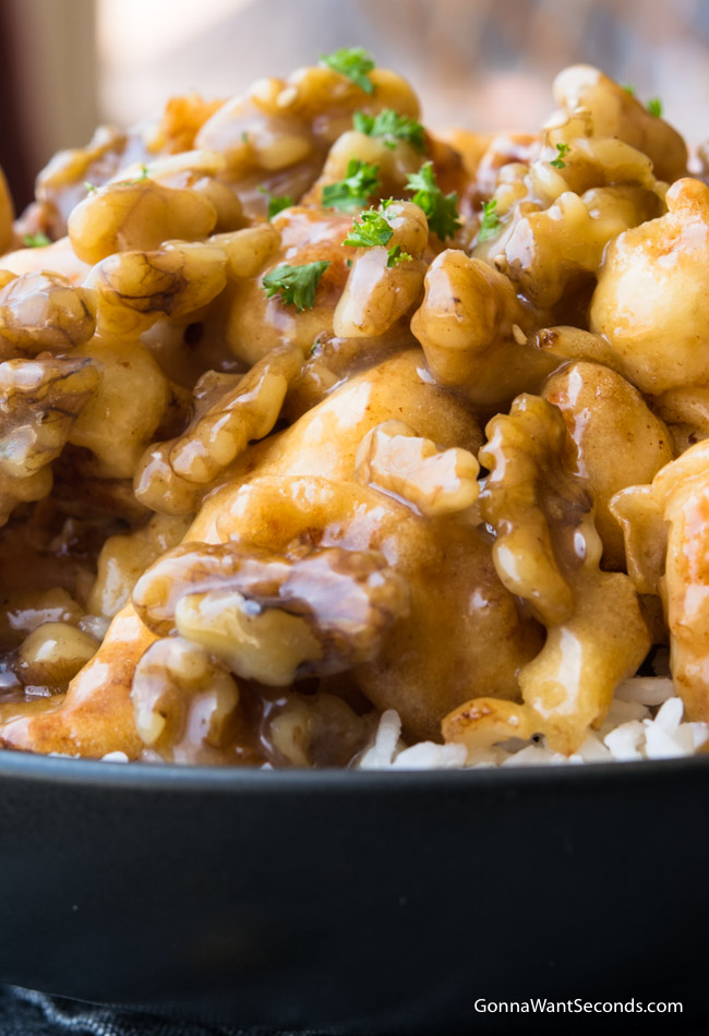 A bowl of rice topped with Honey Walnut Shrimp