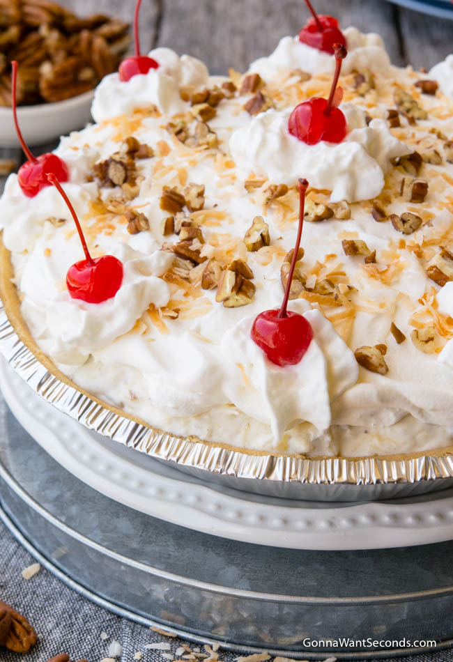 Million Dollar Pie topped whipped topping, cherries, pecans, and toasted coconuts
