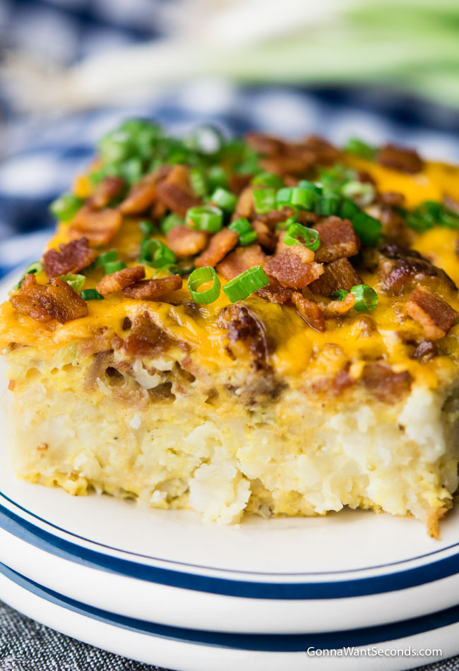 Tater Tot Breakfast Casserole on a plate, topped chopped with green onions and bacon