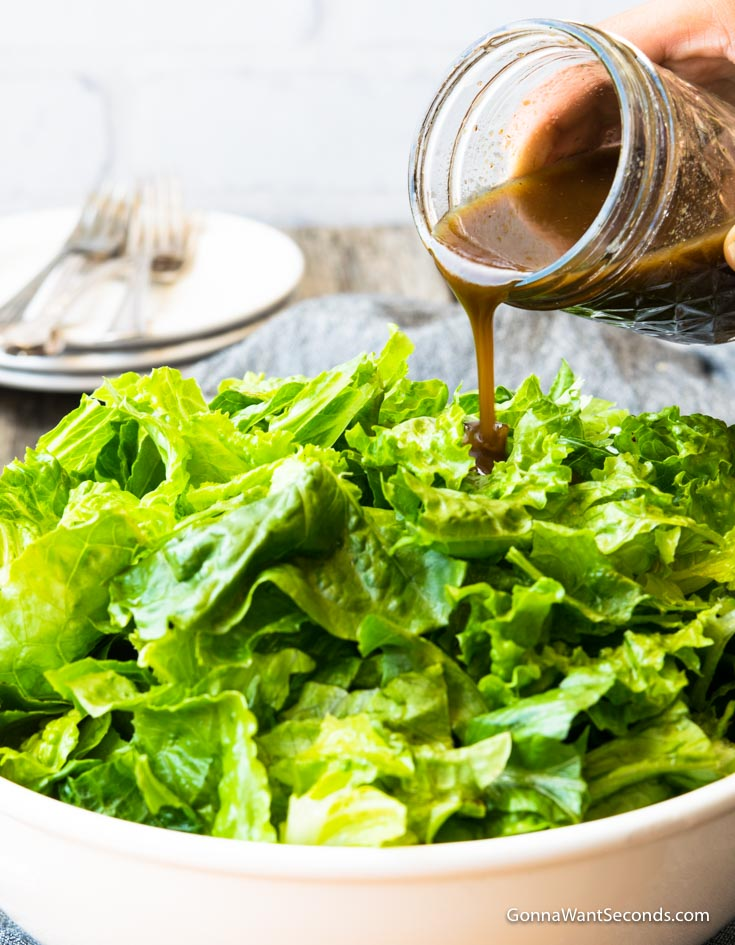 Homemade Balsamic Vinaigrette in a jar poured over salad