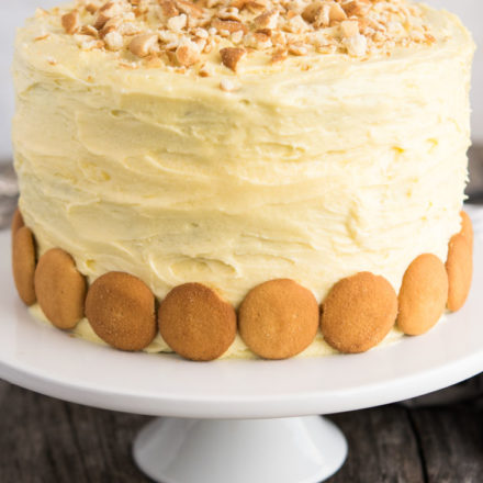 Banana Pudding Cake garnished with Vanilla Wafers on a cake stand