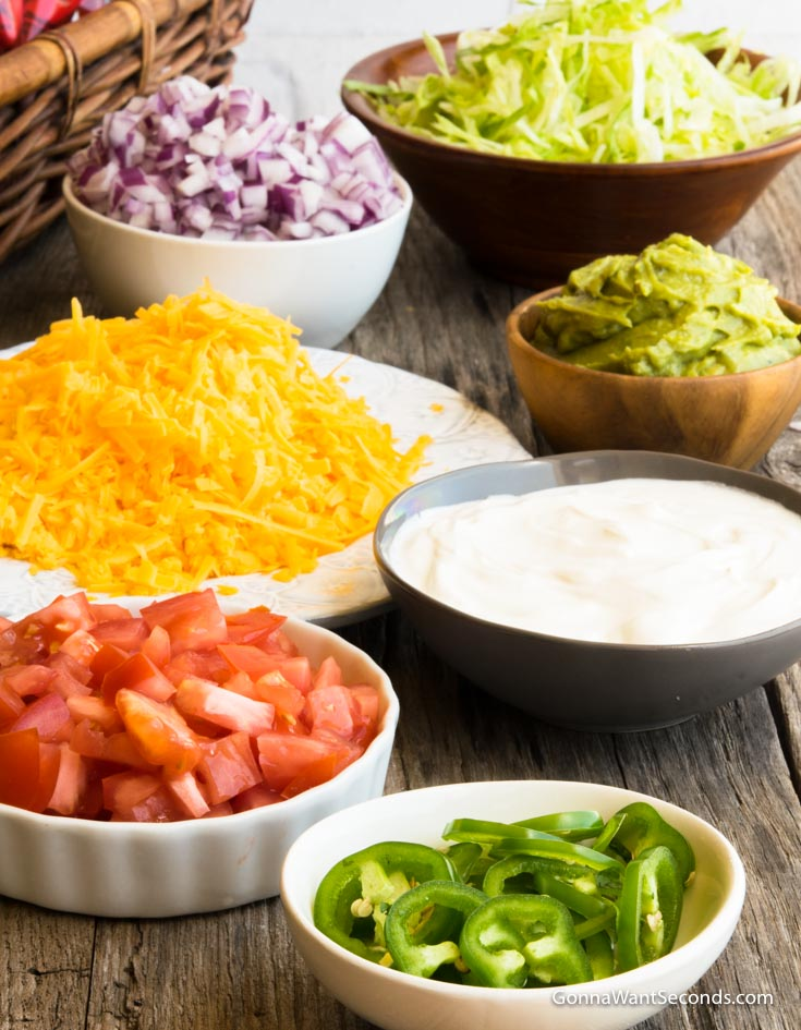 Toppings for Walking Taco prepared in individual bowls