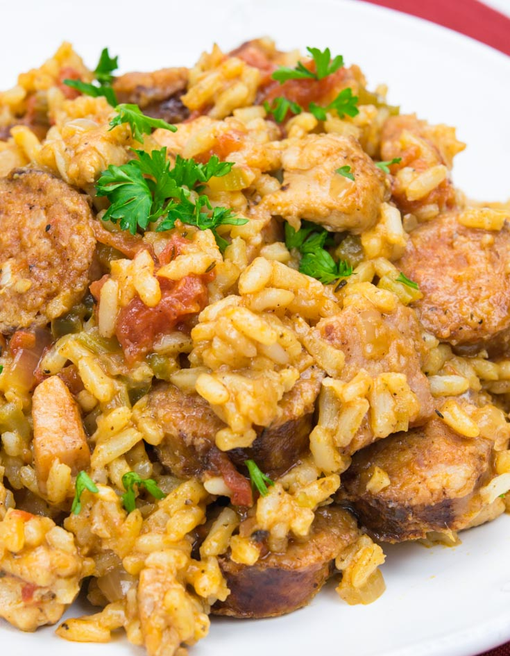 Jambalaya topped with chopped parsley on a plate