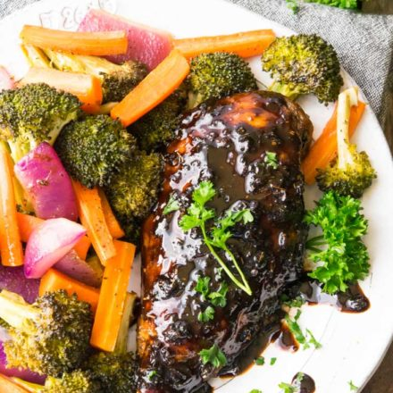 Honey Balsamic Sheet Pan Chicken with broccoli, carrots, and onions on a plate