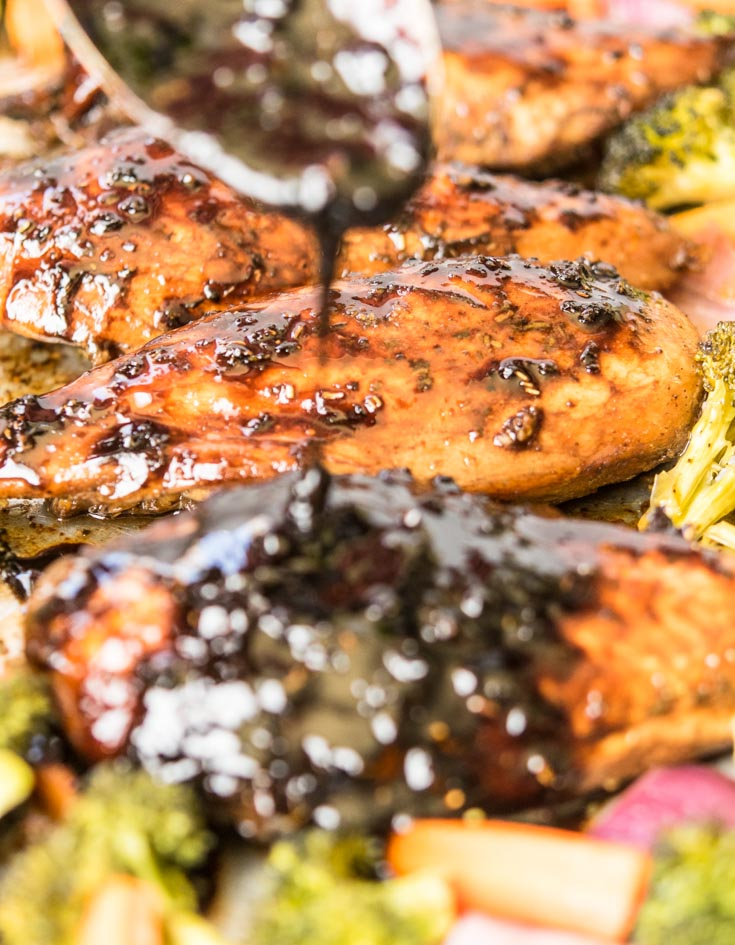 Honey Balsamic Sheet Pan Chicken drizzled with sauce