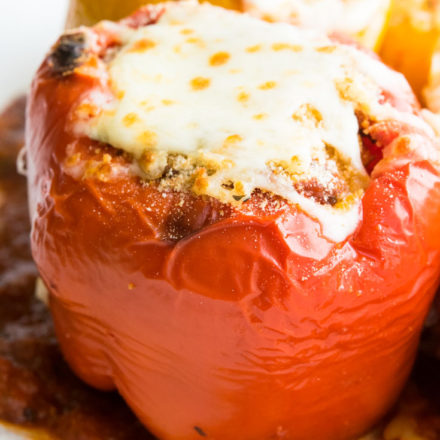 Italian Stuffed Peppers topped with melted mozzarella cheese