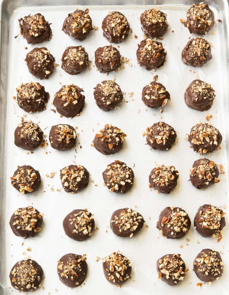Bourbon Balls arranged on a baking sheet pan