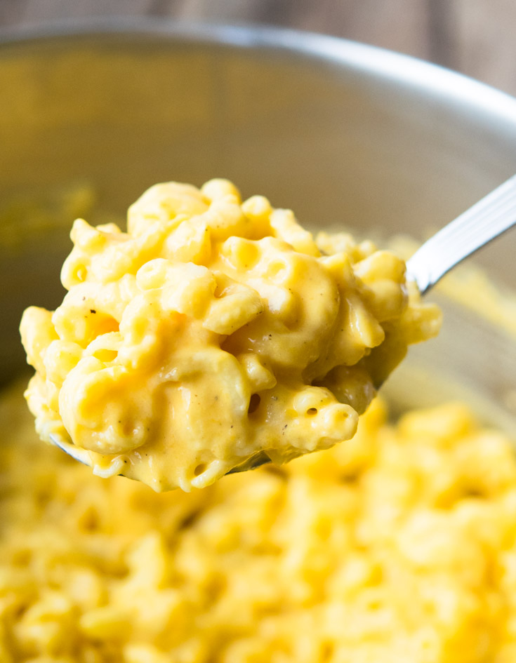 Scooping Pioneer Woman Mac and Cheese from a pot