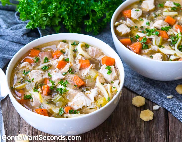 Two bowls of Chicken Noodle Soup in white bowls.