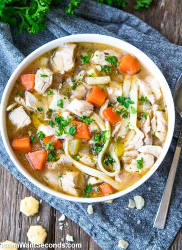 Chicken Noodle Soup in a white bowl, top shot