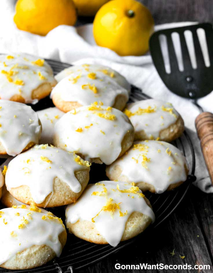 Lemon Ricotta Cookies with lemon glaze, garnish with lemon zest, on top of each other