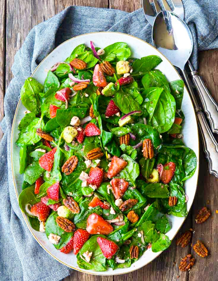 Strawberry Spinach Salad on a serving plate, top shot
