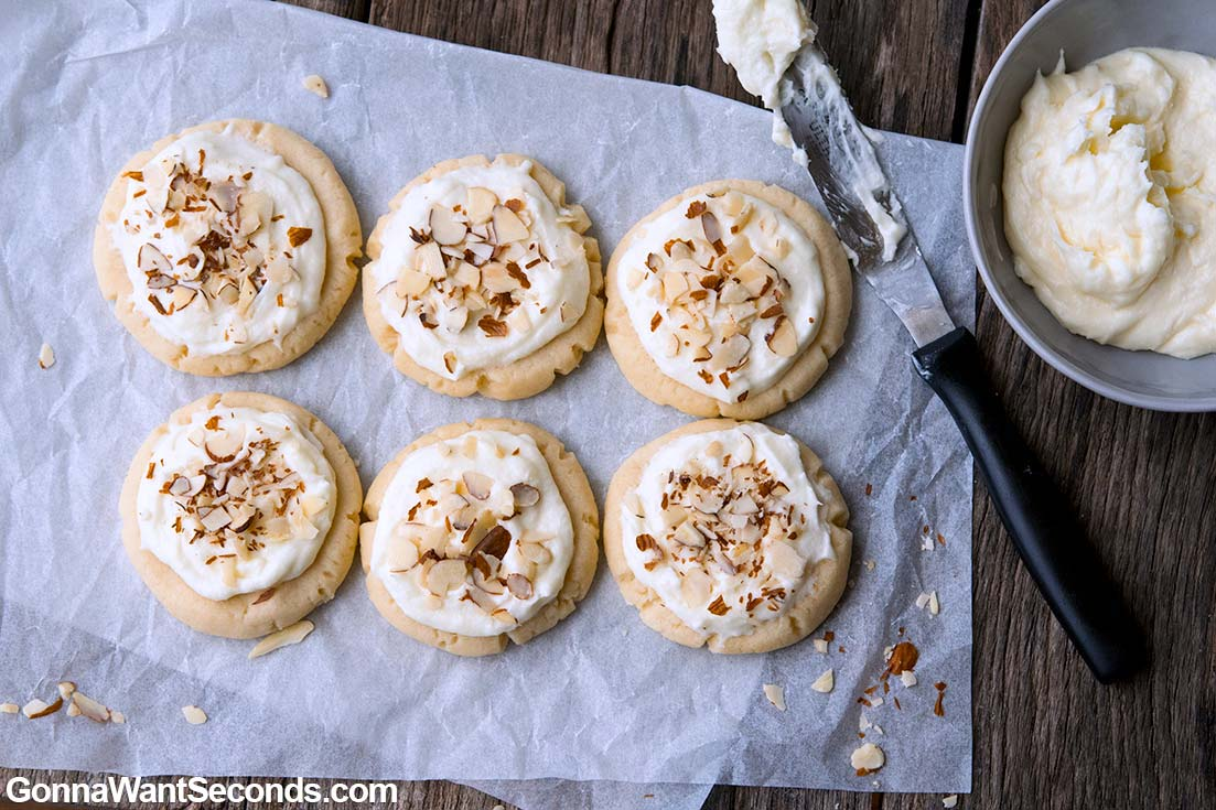 Almond Cookies with frosting and sliced almonds on top