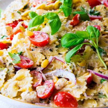 Pesto Pasta Salad on an oval serving plate