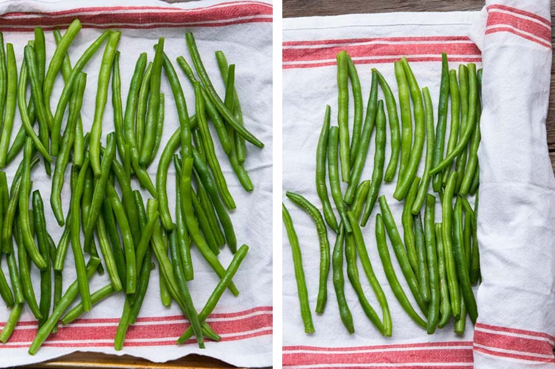 Fresh green beans being dried on a dish towel