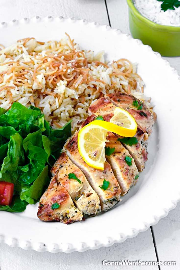 Greek Chicken with rice on a plate