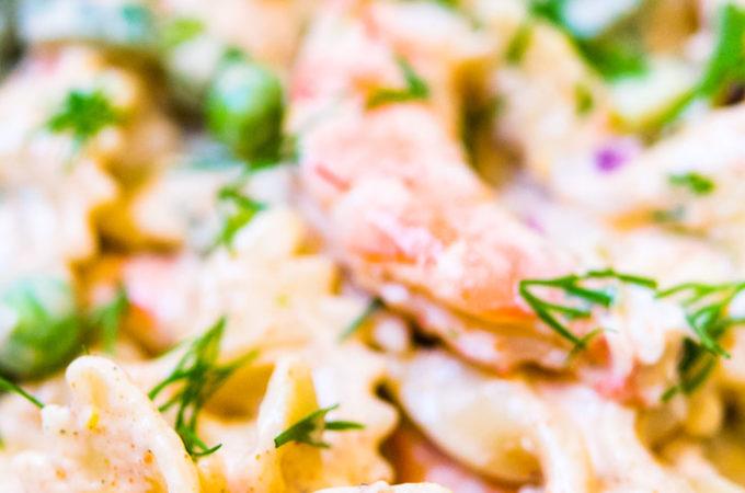 Close up, Shrimp Pasta Salad garnished with fresh dill