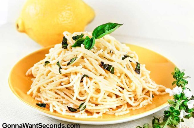 Lemon Garlic Pasta topped with fresh basil on a plate