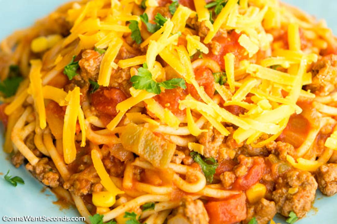 Spaghetti Recipes, Mexican Spaghetti topped with shredded cheese and parsley
