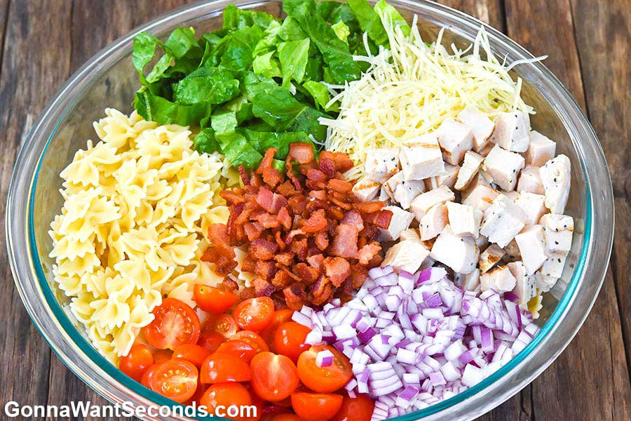Caesar Pasta Salad ingredients in a bowl
