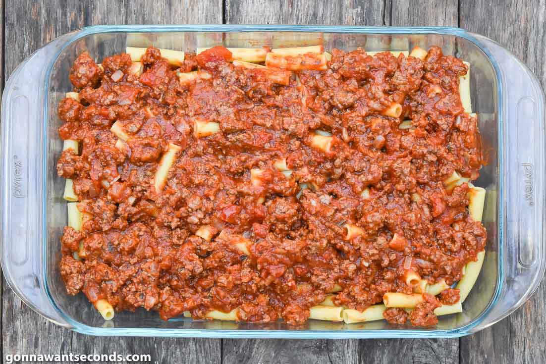 How To Make Baked ziti with ricotta, layering pasta and sauce in a casserole dish
