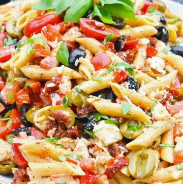 Mediterranean Pasta Salad on a plate, garnished with fresh basil