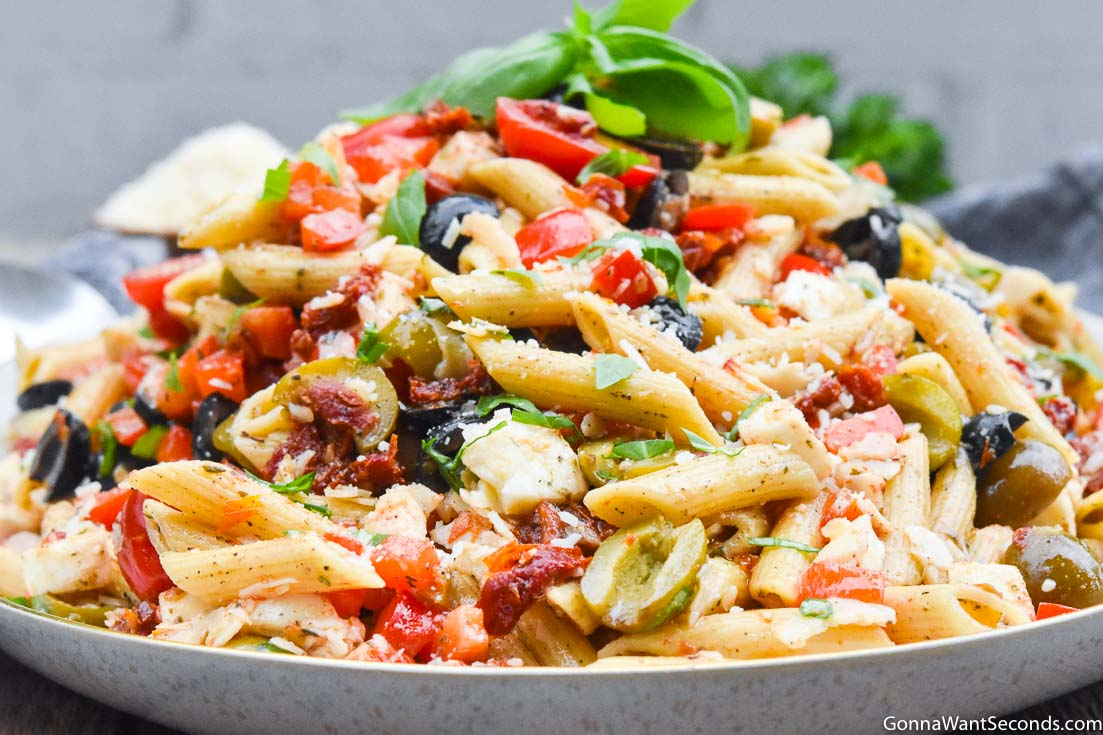 Pasta Salad Recipes: Mediterranean pasta salad on a large serving plate