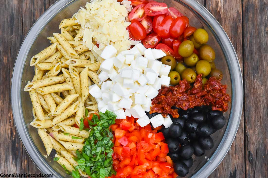Mediterranean pasta salad ingredients in a bowl