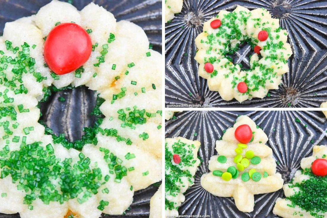 Cream Cheese spritz cookies, decorated with green sugar, red hots, sprinkles, and jimmies, on a baking sheet