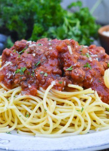 crockpot spaghetti sauce poured on top of spaghetti pasta