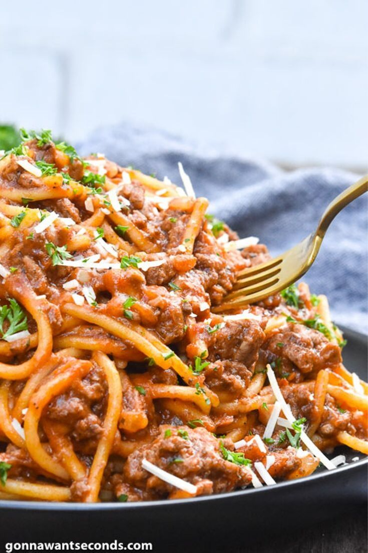 Fork picking Instant Pot Spaghetti on a plate