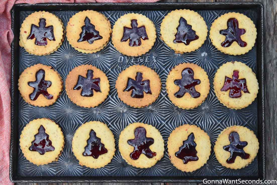 Linzer cookies arranged on a baking sheet
