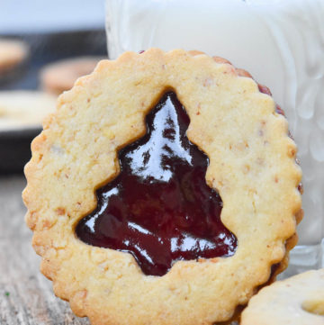 Linzer cookies and a glass of milk