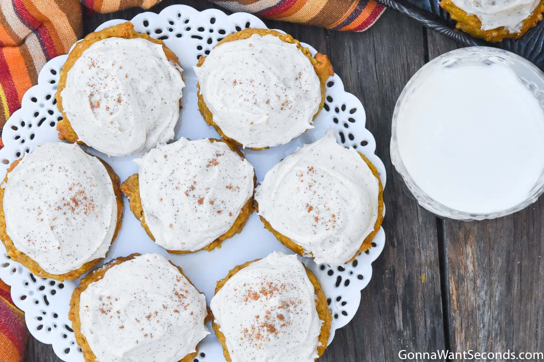 Pumpkin oatmeal cookies with cream cheese frosting, on a plate