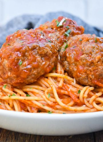 spaghetti and meatballs recipe on a plate