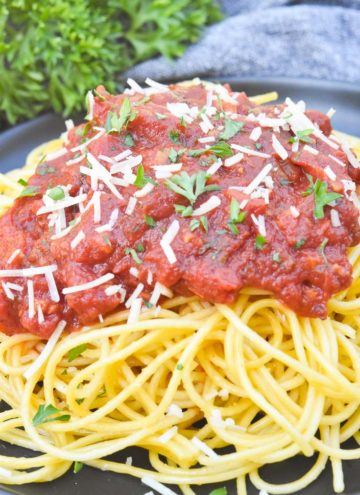 Spaghetti Meat Sauce poured over spaghetti, on a plate