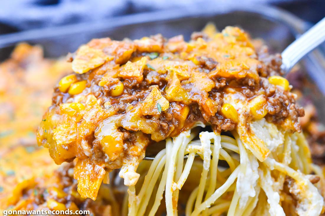 Scooping Taco Spaghetti from the casserole dish