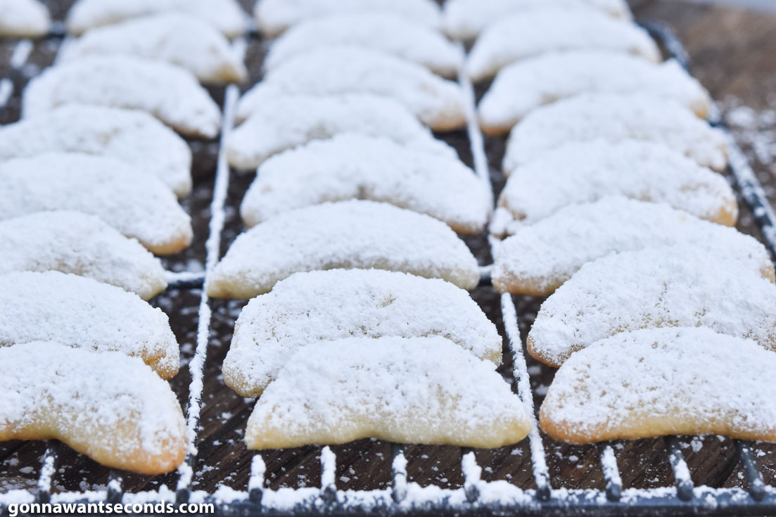 almond crescent cookies on a cooling rack