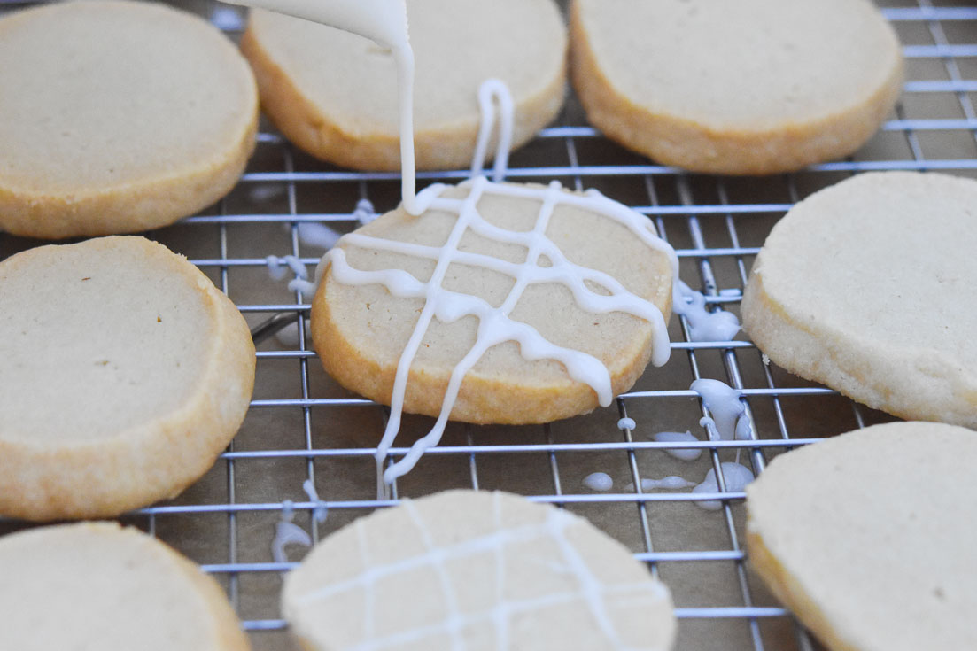 almond shortbread cookies on a cooling rack