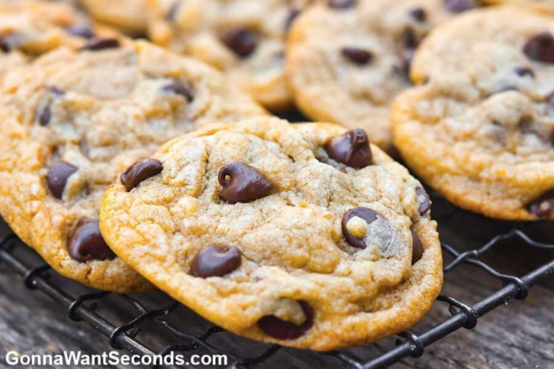 Alton Brown chocolate chip cookies arranged on a cooling rack