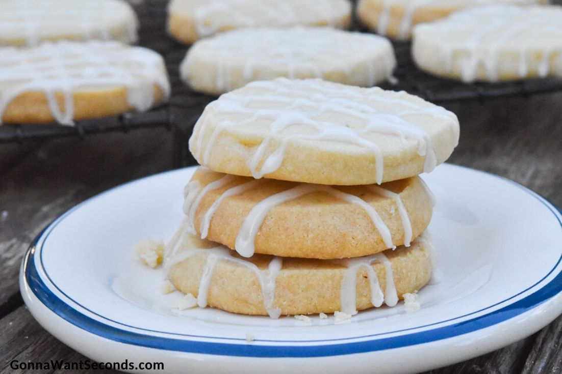 almond shortbread cookies piled on top of each other, on a plate