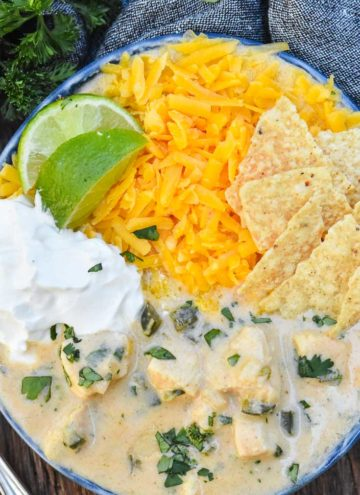 Creamy chicken tortilla soup with toppings, in a bowl