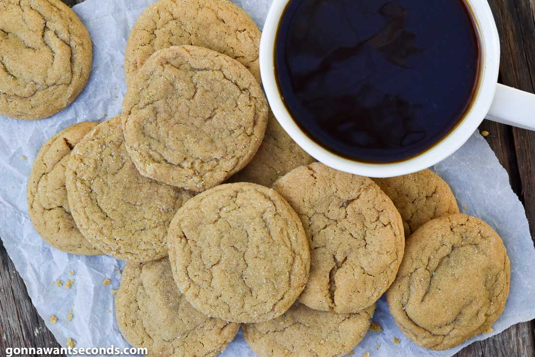 ginger molasses cookies with a cup of coffee on the side